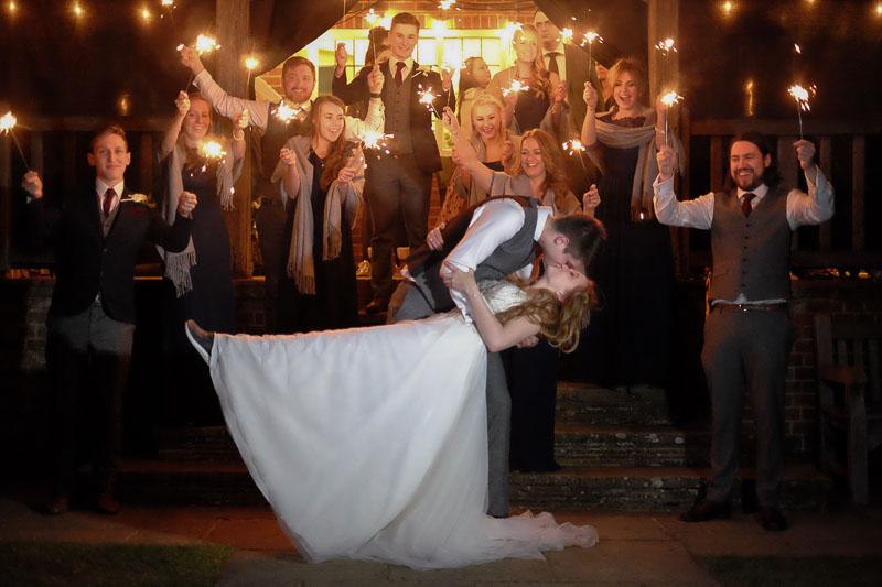 Surrey wedding photographer - bride and groom sparkler dip