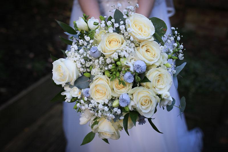Surrey wedding photographer - bridal bouquet with white roses gypsophila and poppy seedheads
