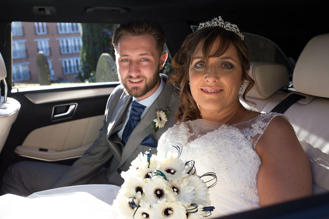 Bride arrives at St Michael's church in Camberley in the wedding car with her son