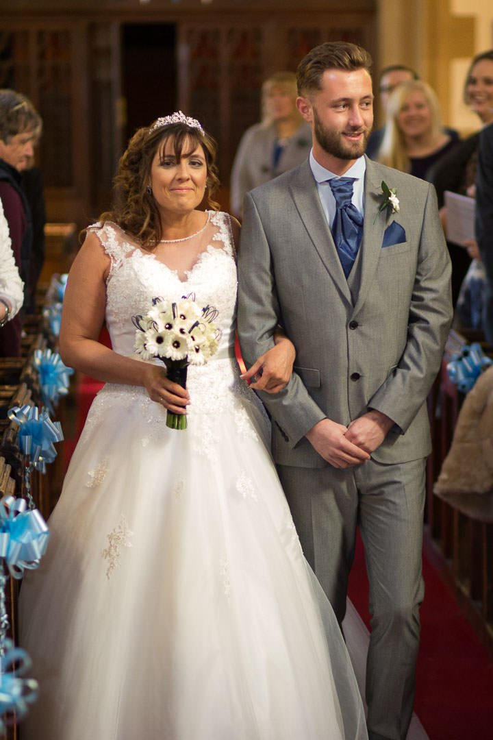 Bride walks up the aisle with her son at St Michael's church in Camberley