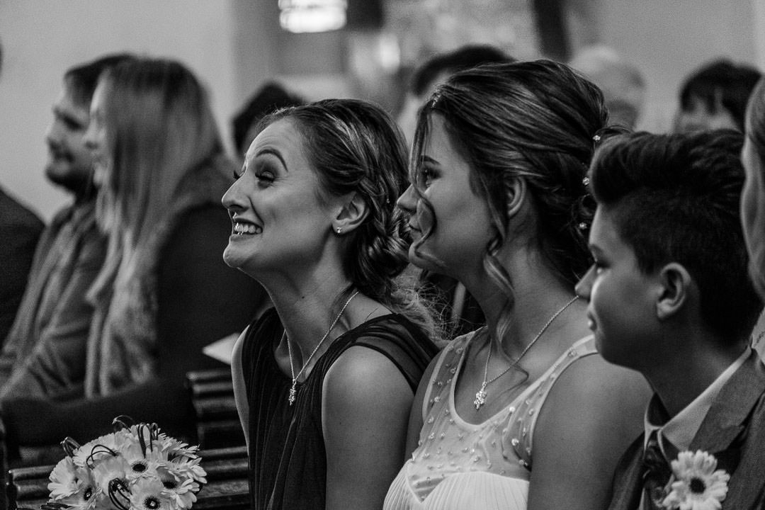 Bridesmaid laughing at St Michael's church in Camberley