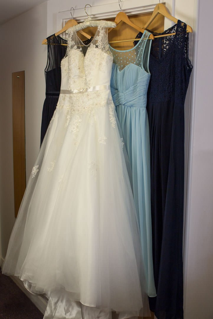 wedding and bridesmaids dresses hanging up