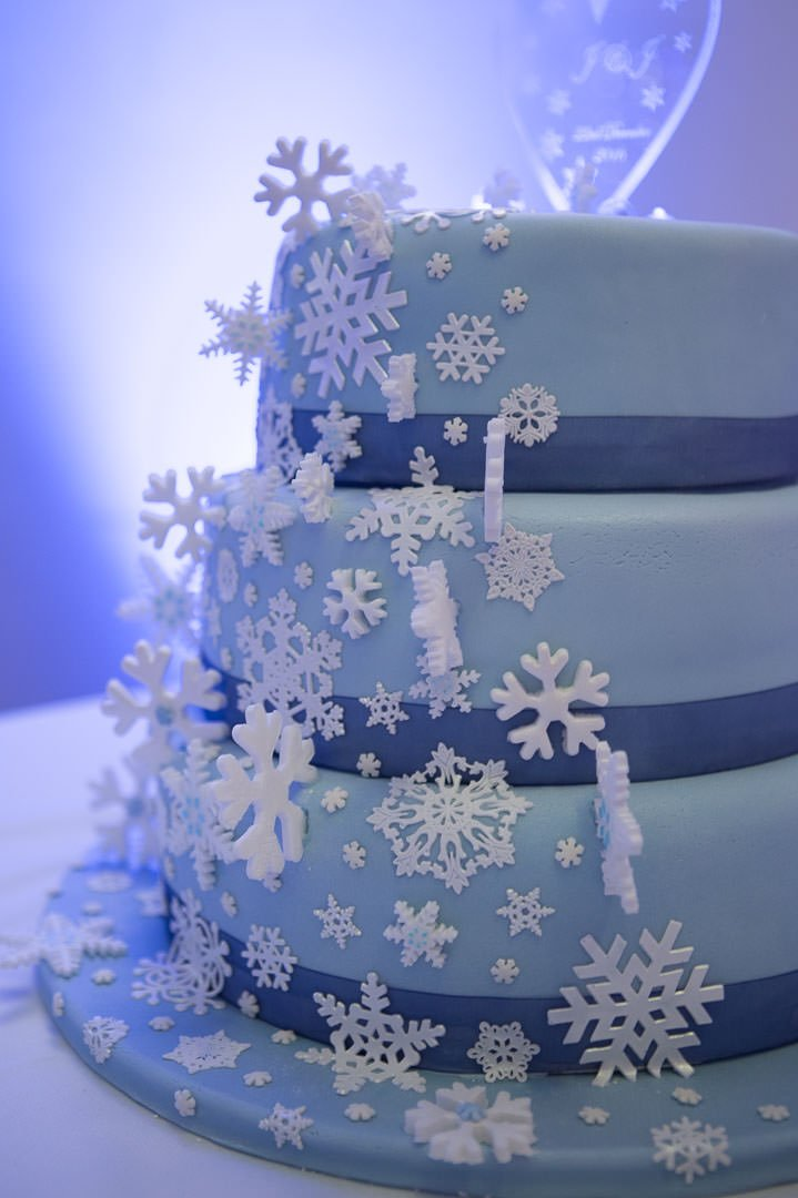 Frozen themed blue snowflake wedding cake