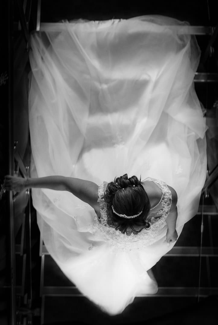 ethereal black and white image of Bride walking down stairs taken from above