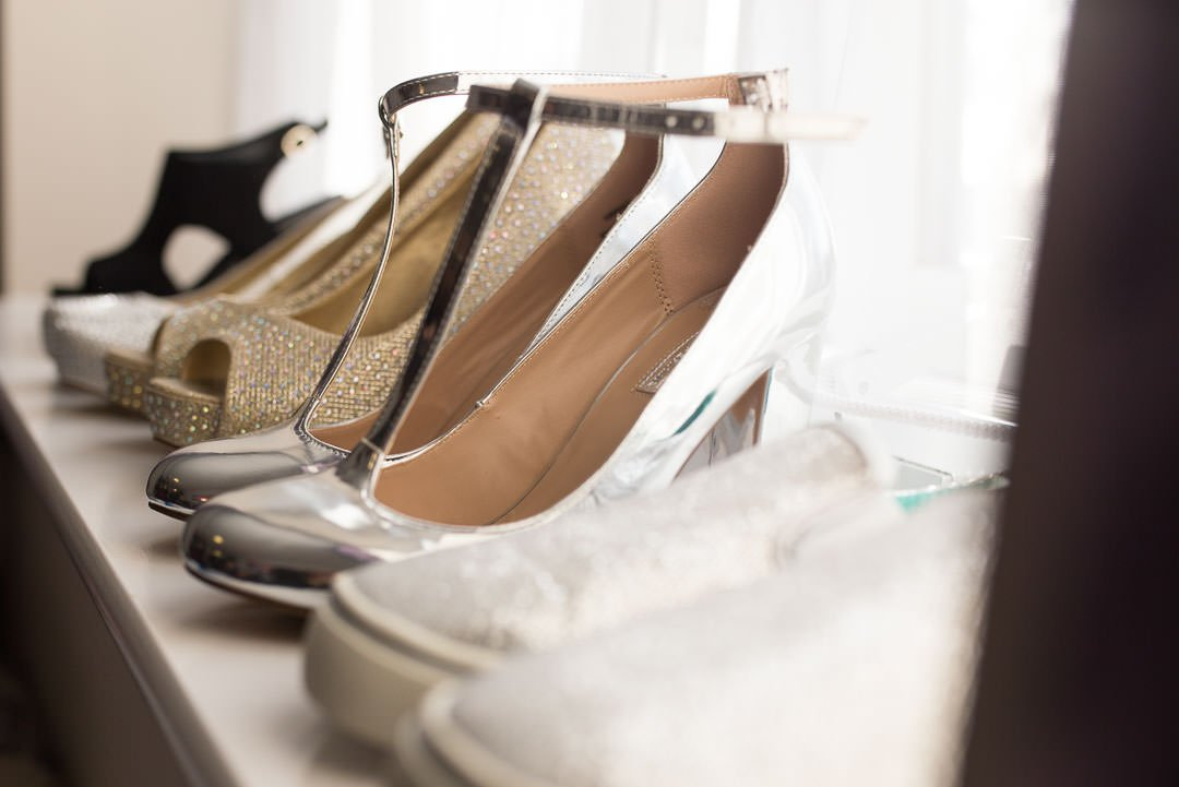 Different styles of bridesmaids shoes all lined up