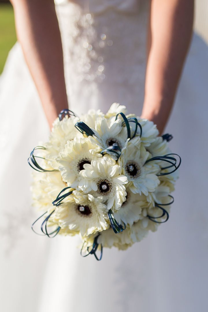 Bride's bouquet of cream gerberas with diamante and blue ribbon