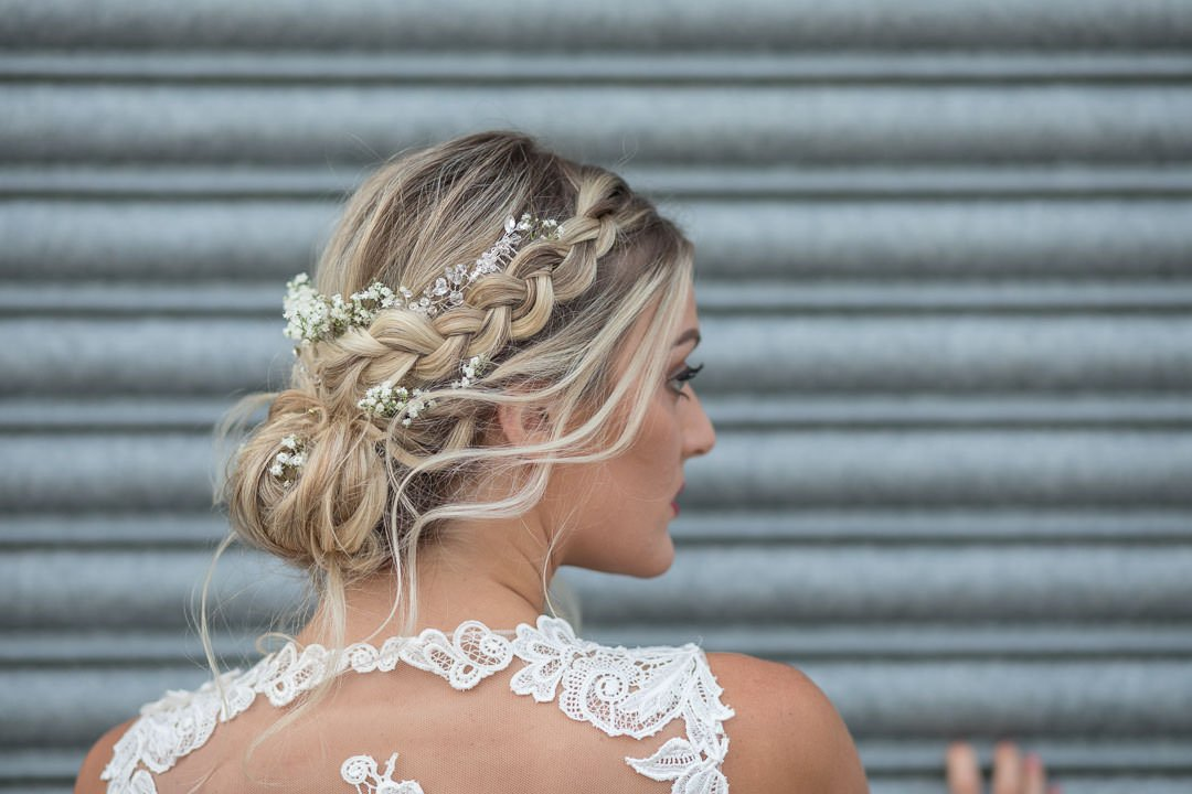 closeup photo of boho bride's up do with gypsophilia and combs in hair