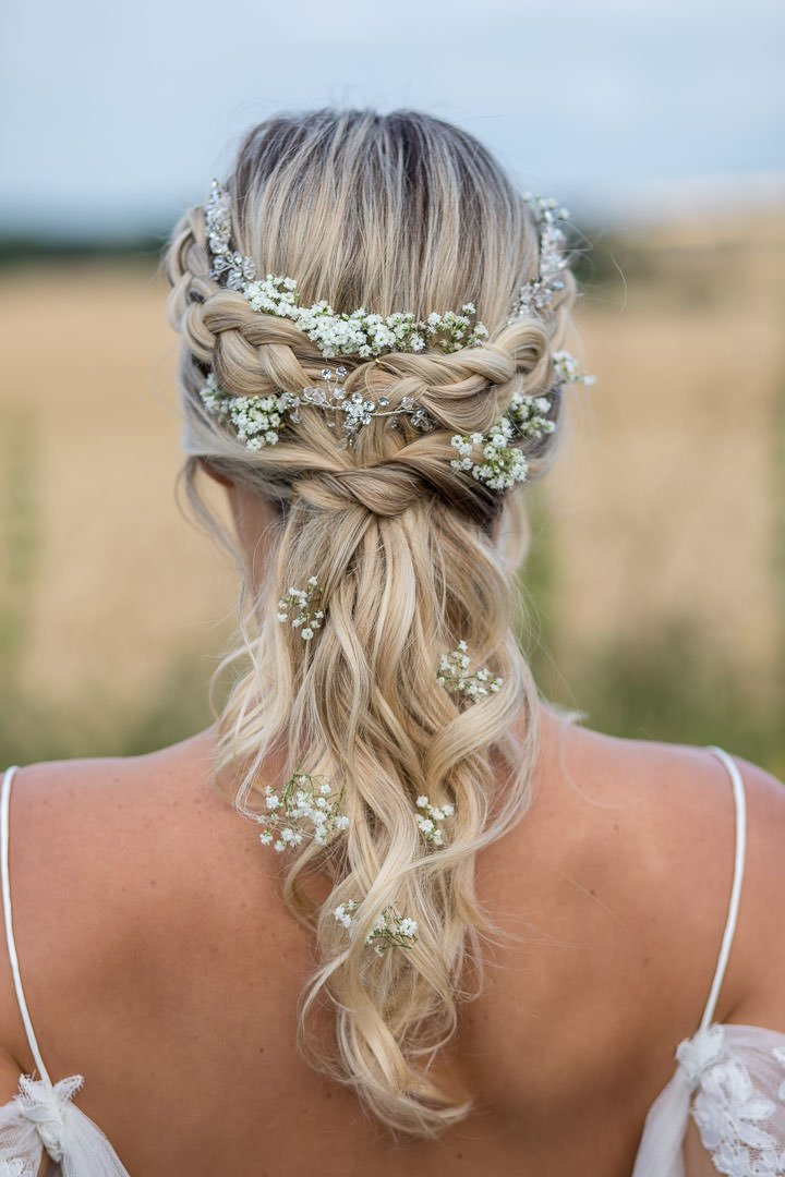 closeup of bride's hair intertwined with gypsophilia flowers and diamante hair vine