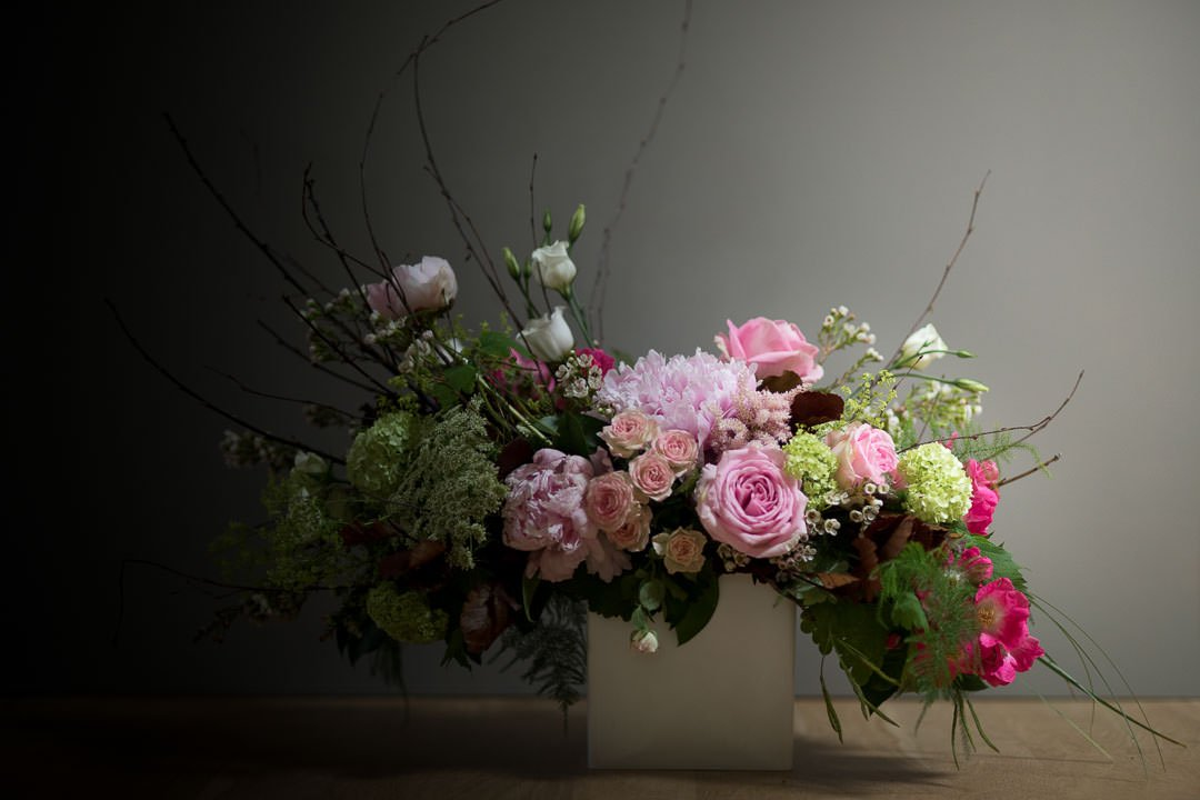 great masters style floral arrangement with roses and peonies