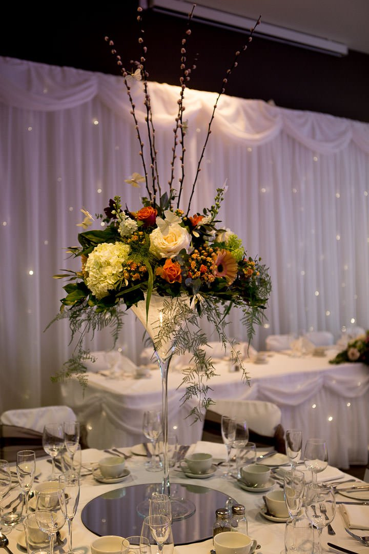 Martini glass wedding flowers at the Village Hotel wedding Fair