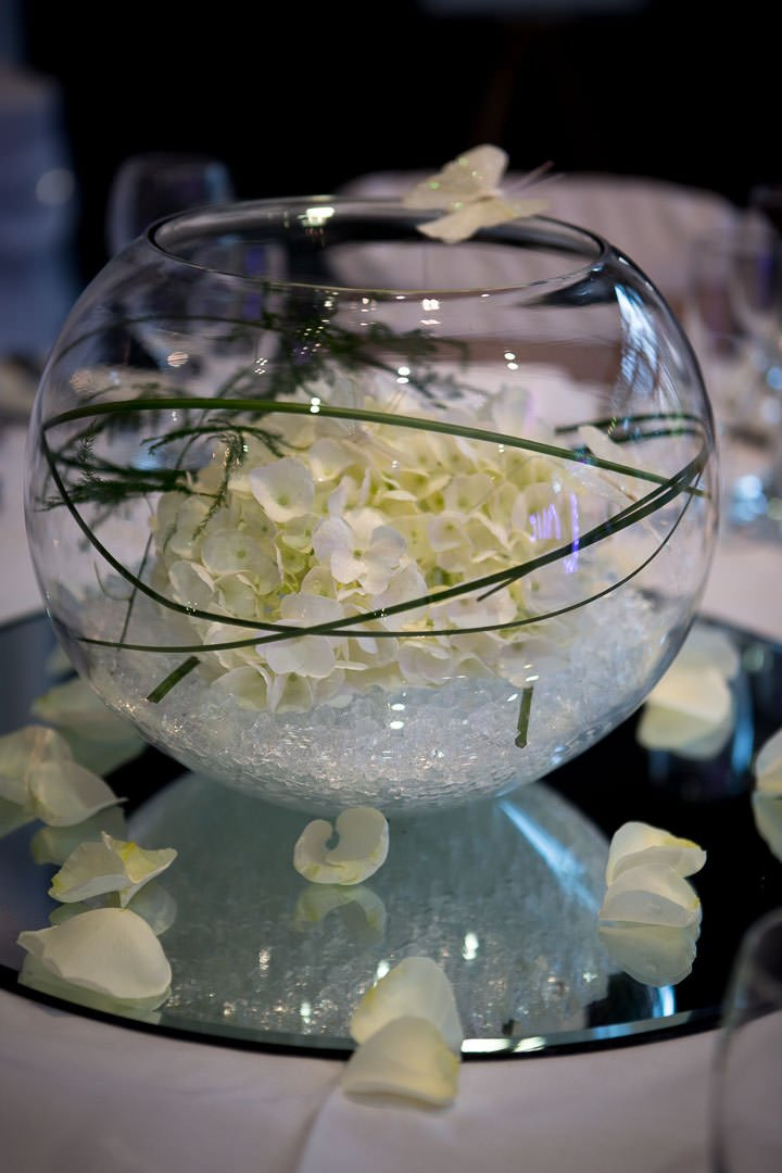 wedding table flower arrangement -fishbowl with stones, hydrangeas and silk butterflies at the Village Hotel wedding Fair