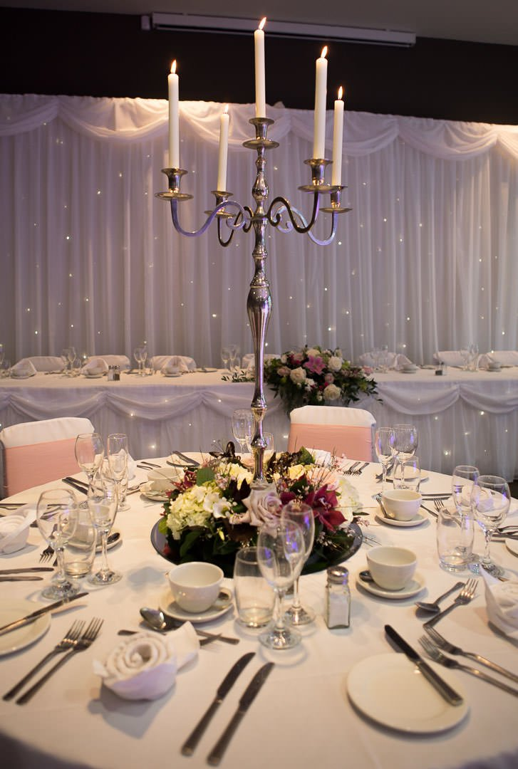 wedding table flower arrangement with candelabra at the Village Hotel wedding Fair