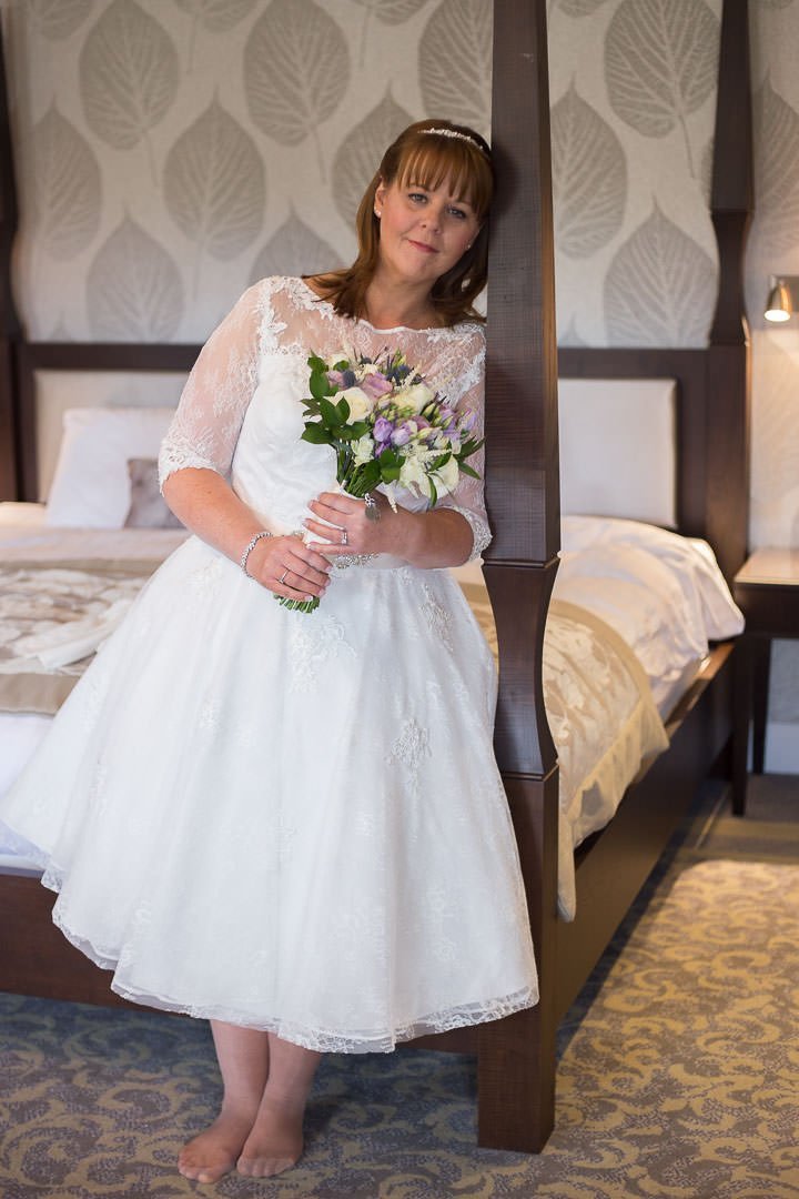 Bridal portrait with her bouquet at Oakley hall in Hampshire