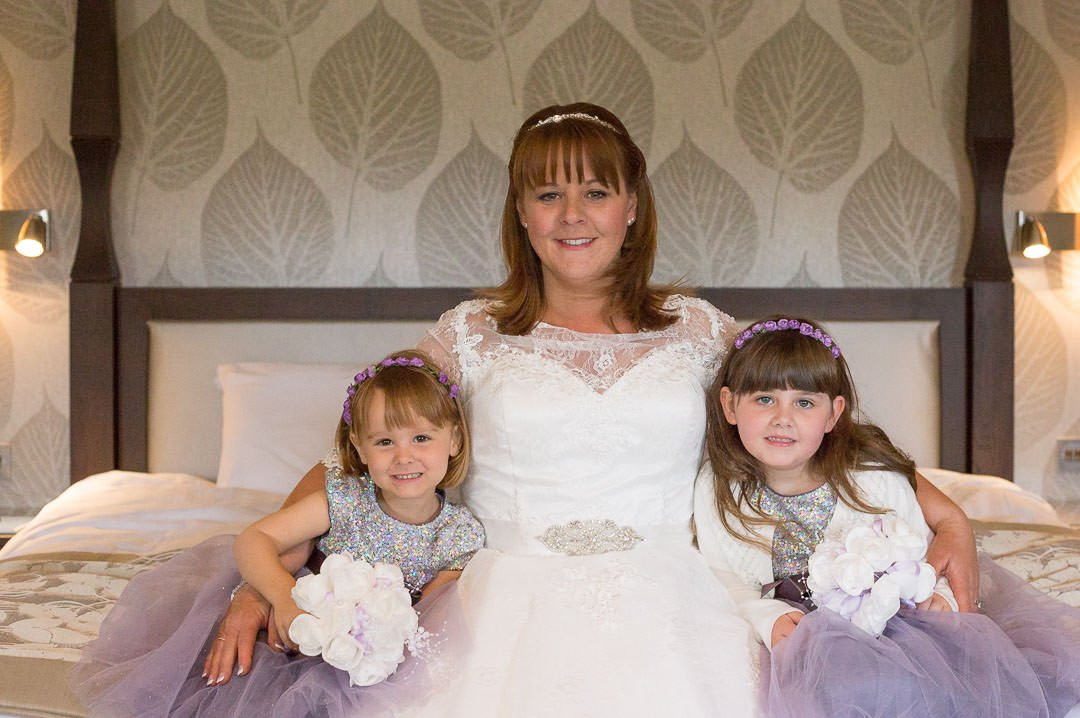 The bride with her two flower girls at Oakley hall in Hampshire