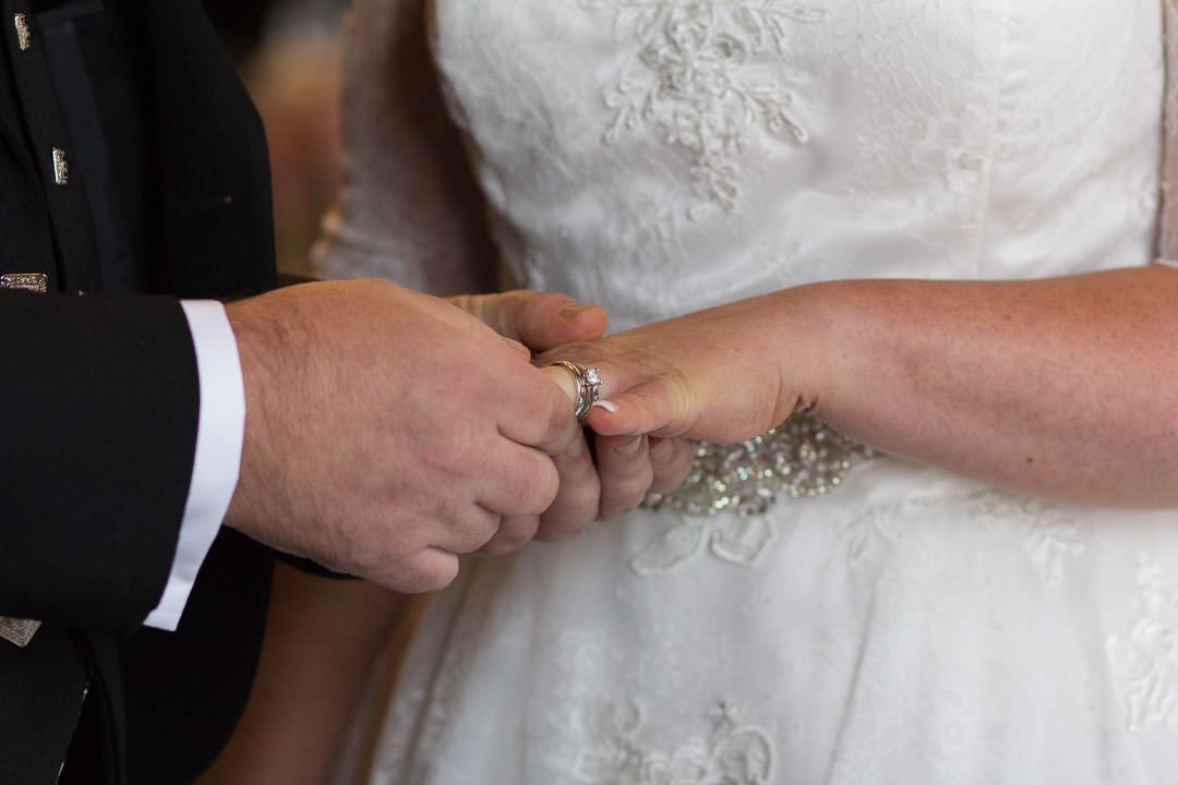 Exchanging of the wedding rings at Oakley Hall in Hampshire