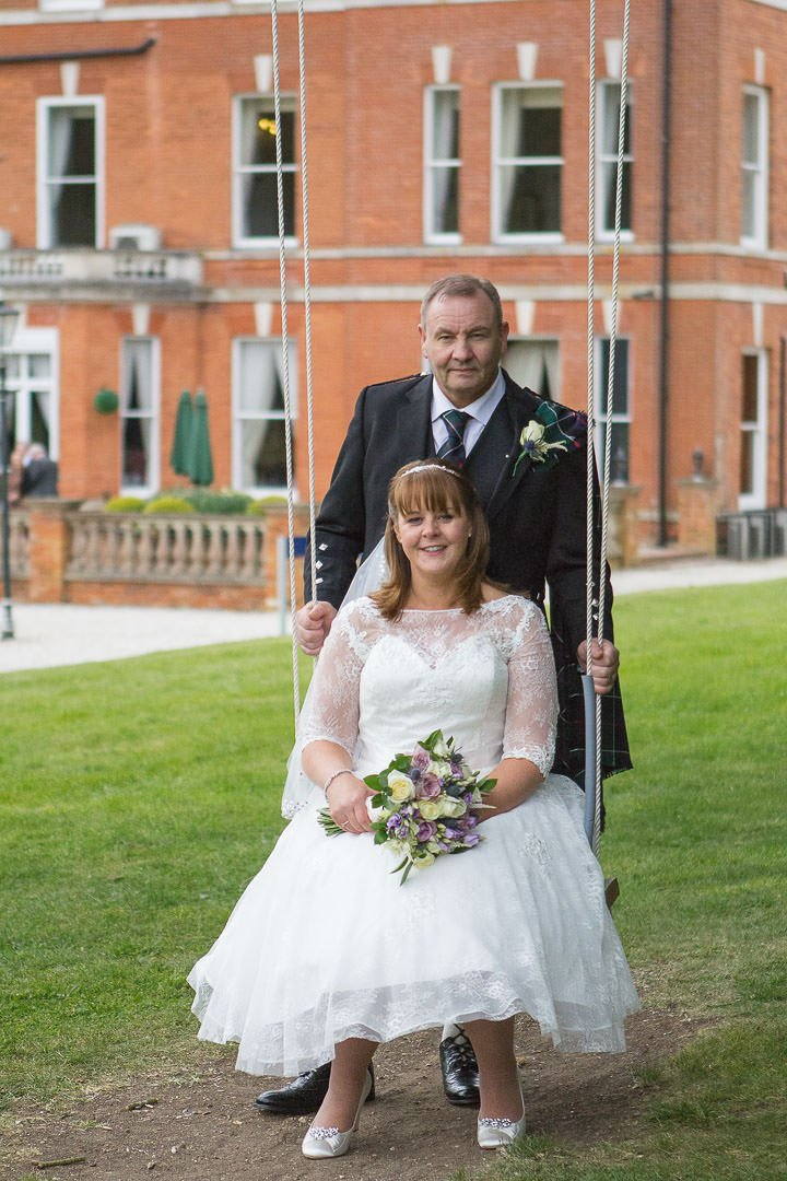 Bride and groom on the swing at Oakley Hall near Basingstoke in Hampshire