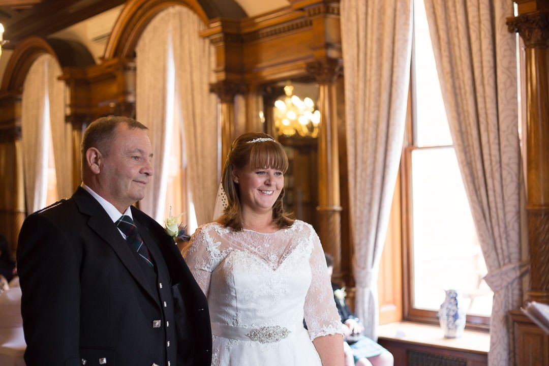 smiling bride and groom during the ceremony at Oakley Hall in Hampshire