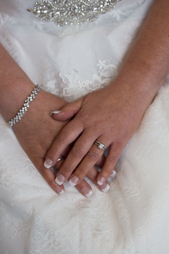 close up of the bride's hands and engagement ring at Oakley Hall