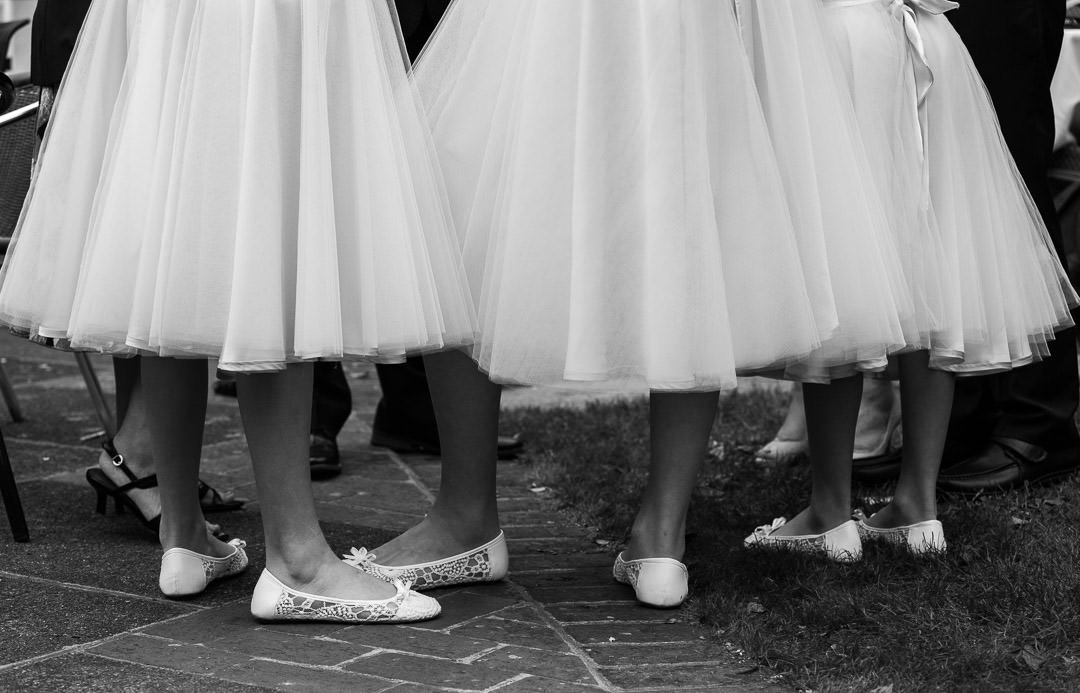 Black and white photograph of bridesmaids standing together at Badgemore Park in Berkshire