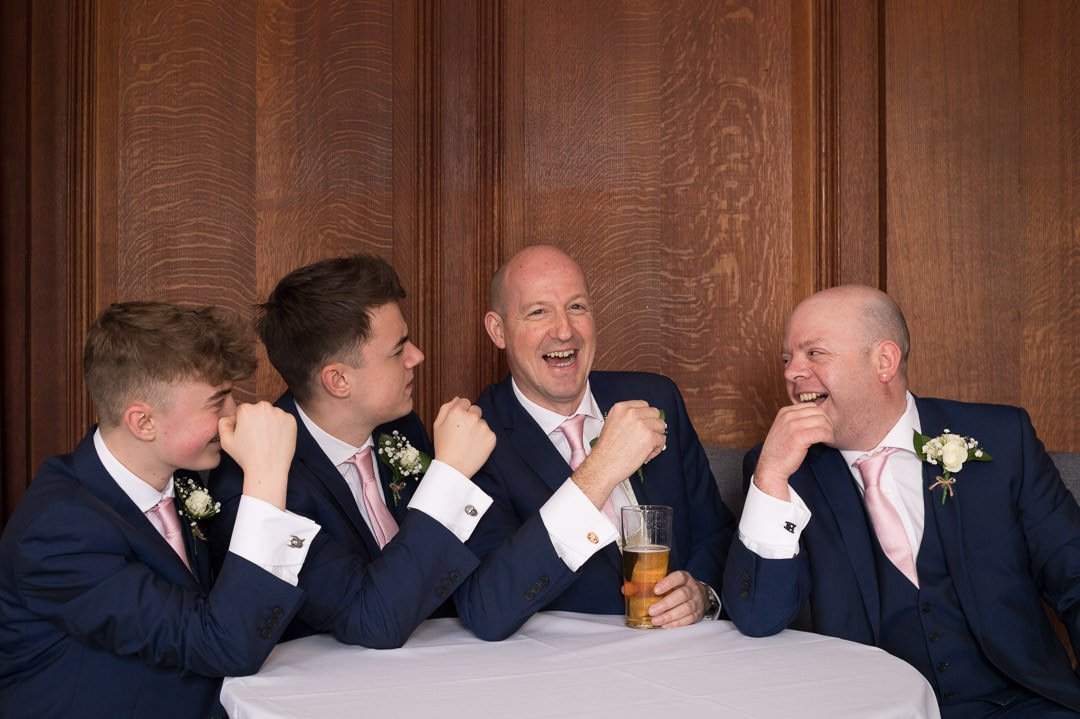 Groom and groomsmen enjoy a pint before the wedding at Barnett Hill Hotel