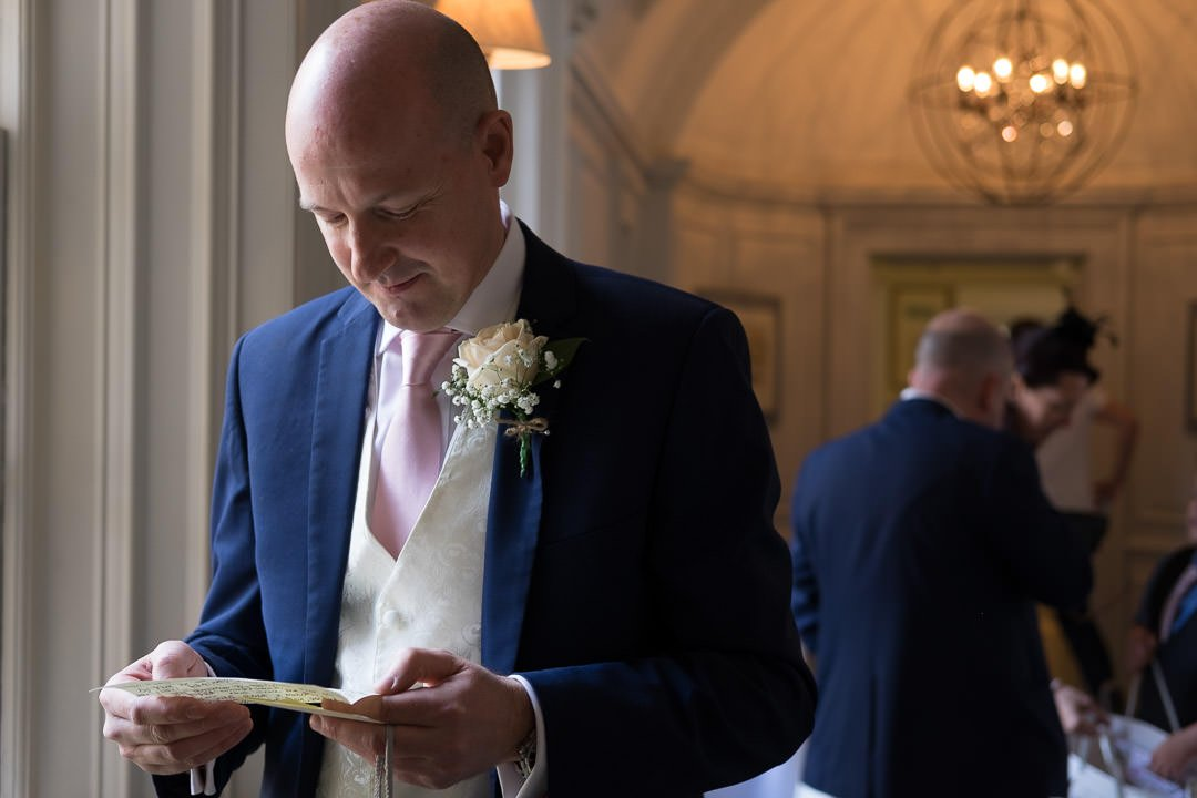 groom reads a letter from the bride before the wedding at Barnett Hill Hotel