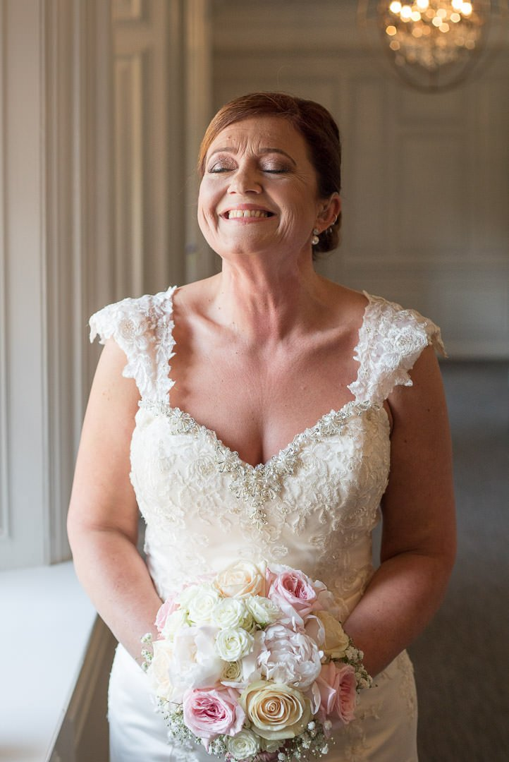 The bride enjoys a smile before the wedding at Barnett Hill Hotel