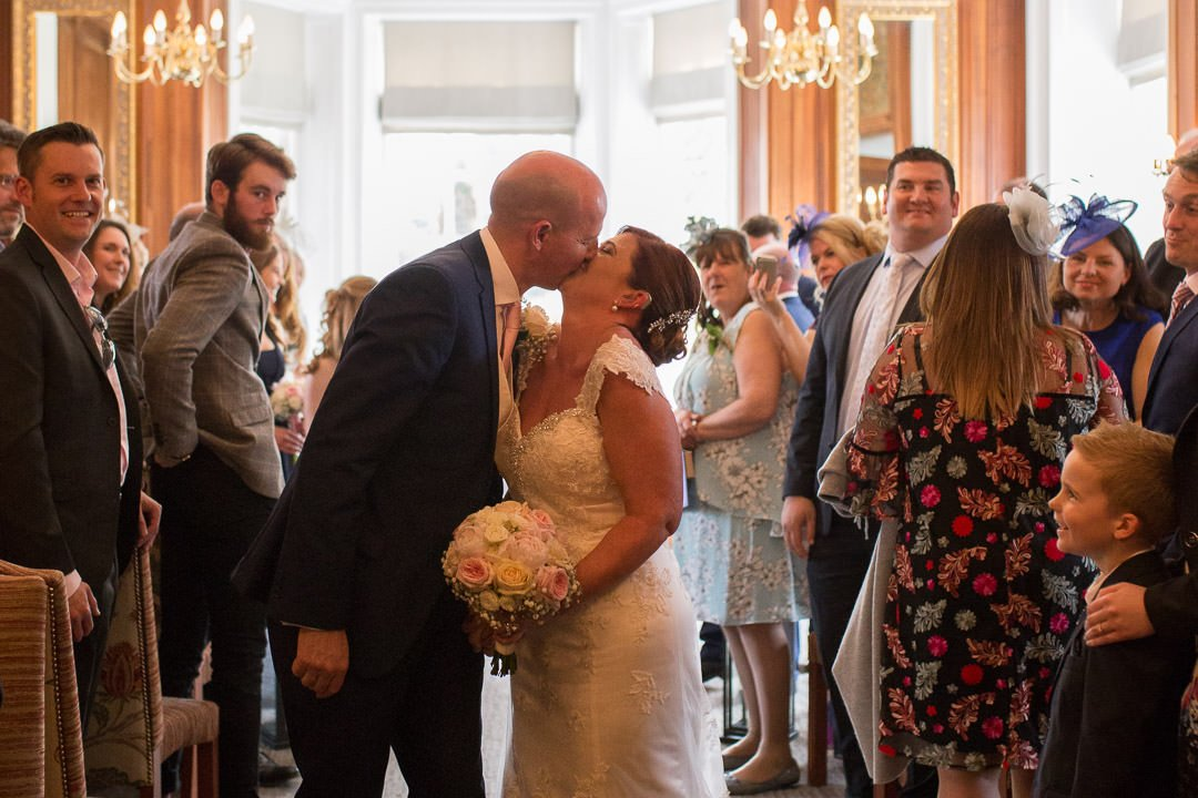 The bride and groom kiss at Barnett Hill Hotel