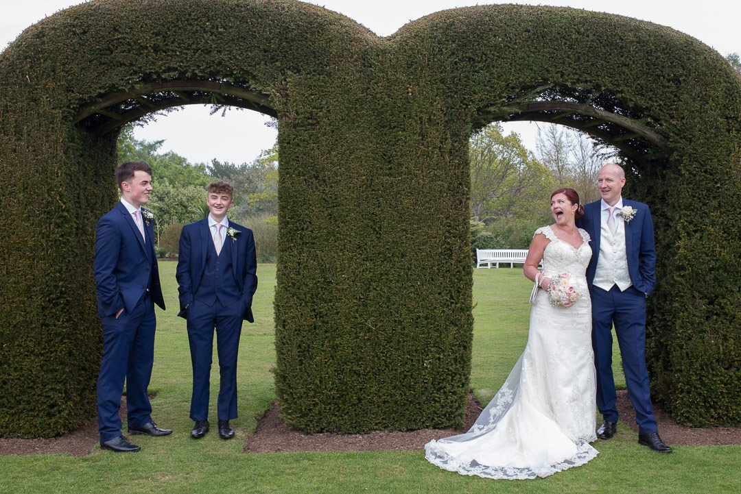 The bride and groom laugh with her sons at Barnett Hill Hotel