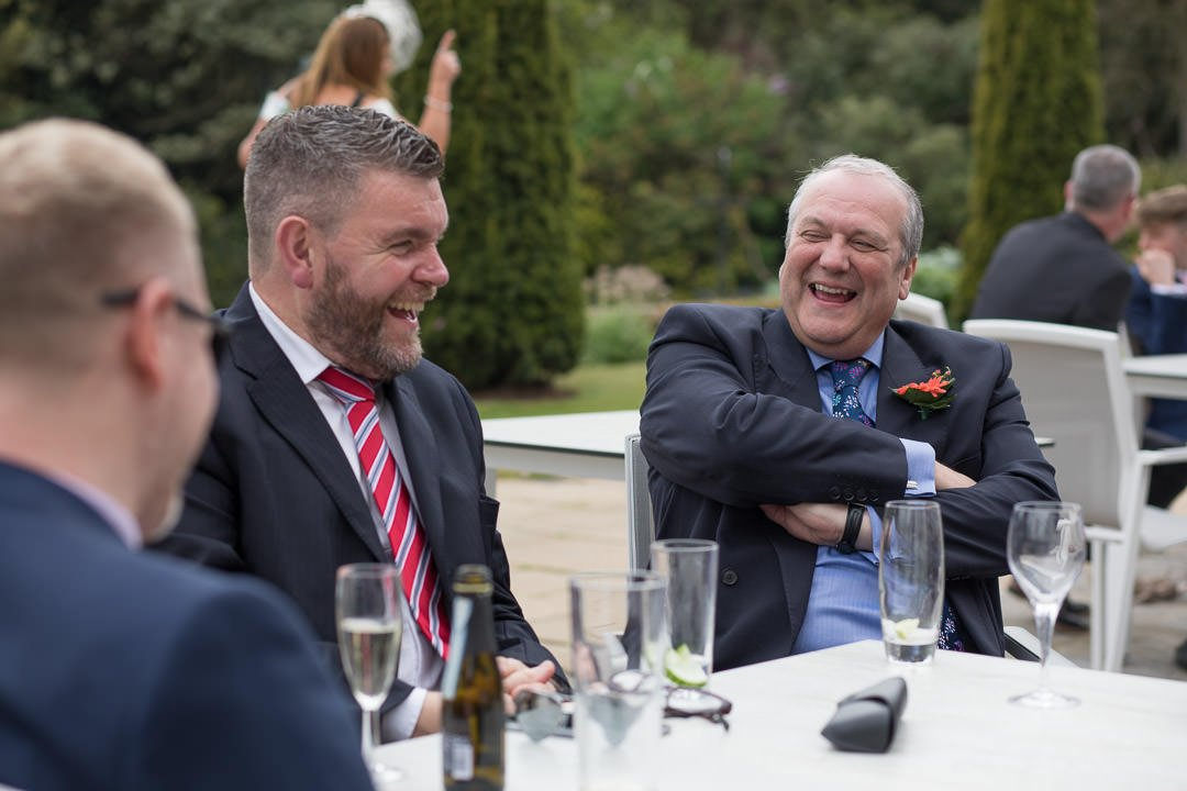 wedding guests laugh together at Barnett Hill Hotel