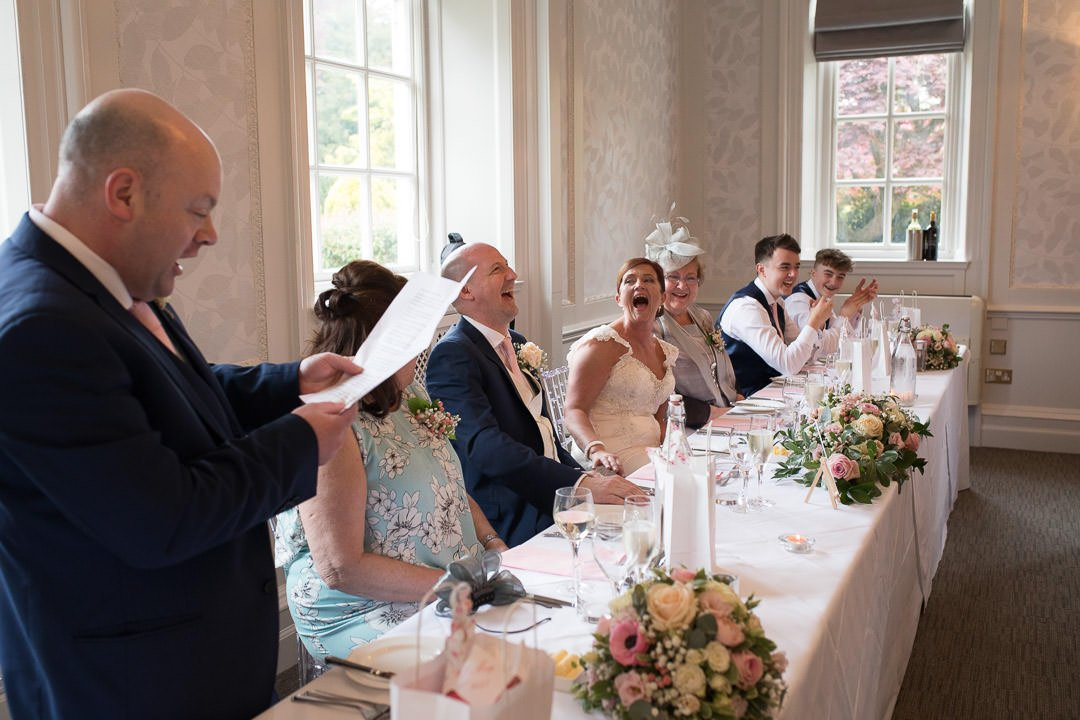 The bridal party laugh at the best man's speech at Barnett Hill Hotel