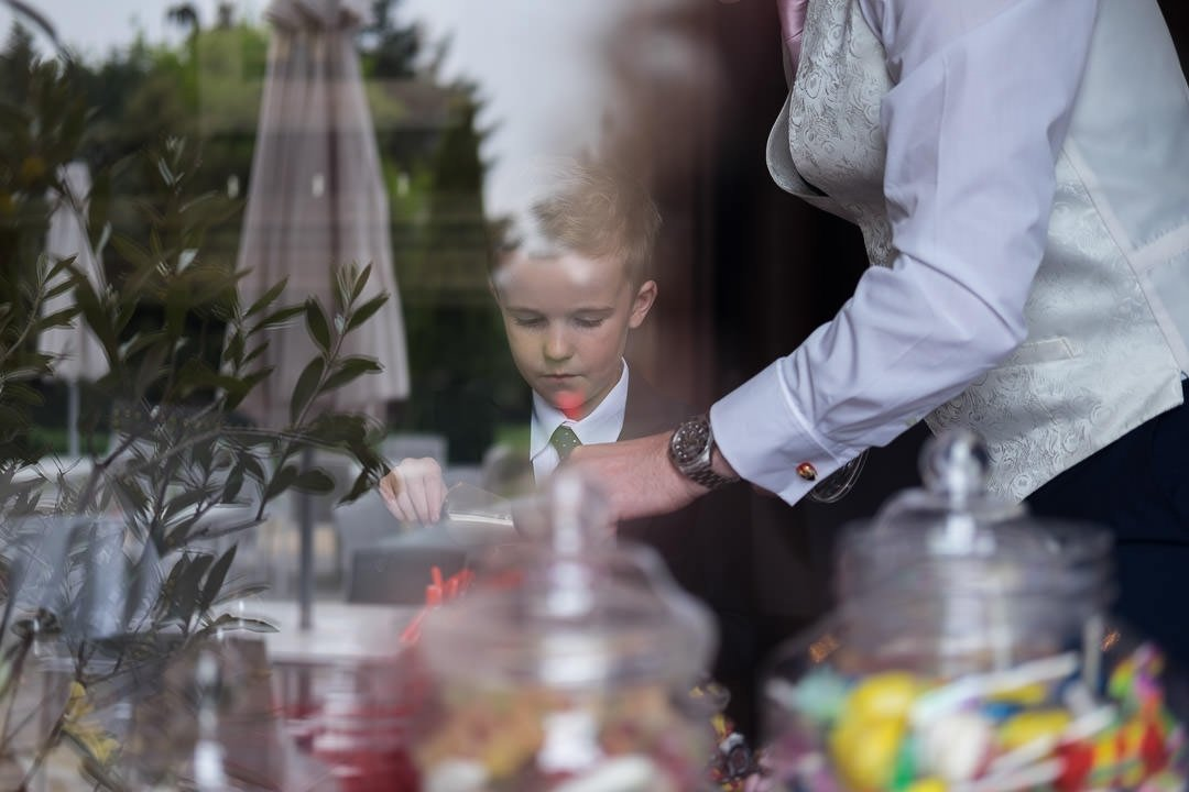 A young wedding guest helps himself to the sweet trolley at Barnett Hill Hotel