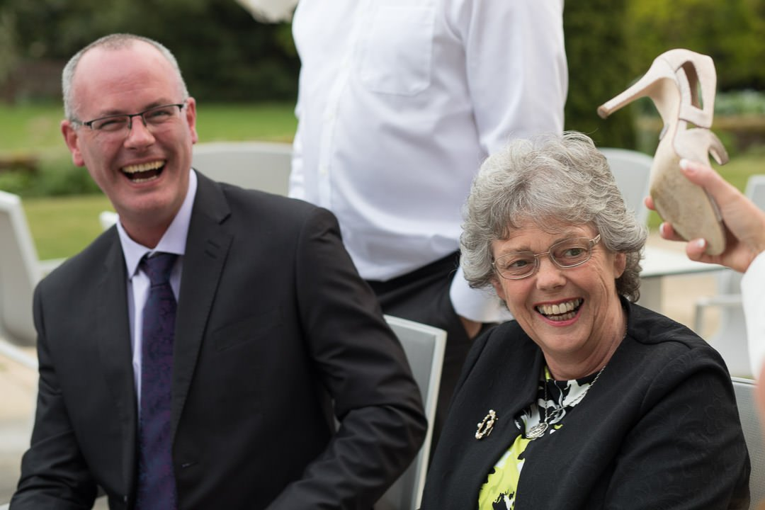 wedding guests enjoy a joke at Barnett Hill Hotel