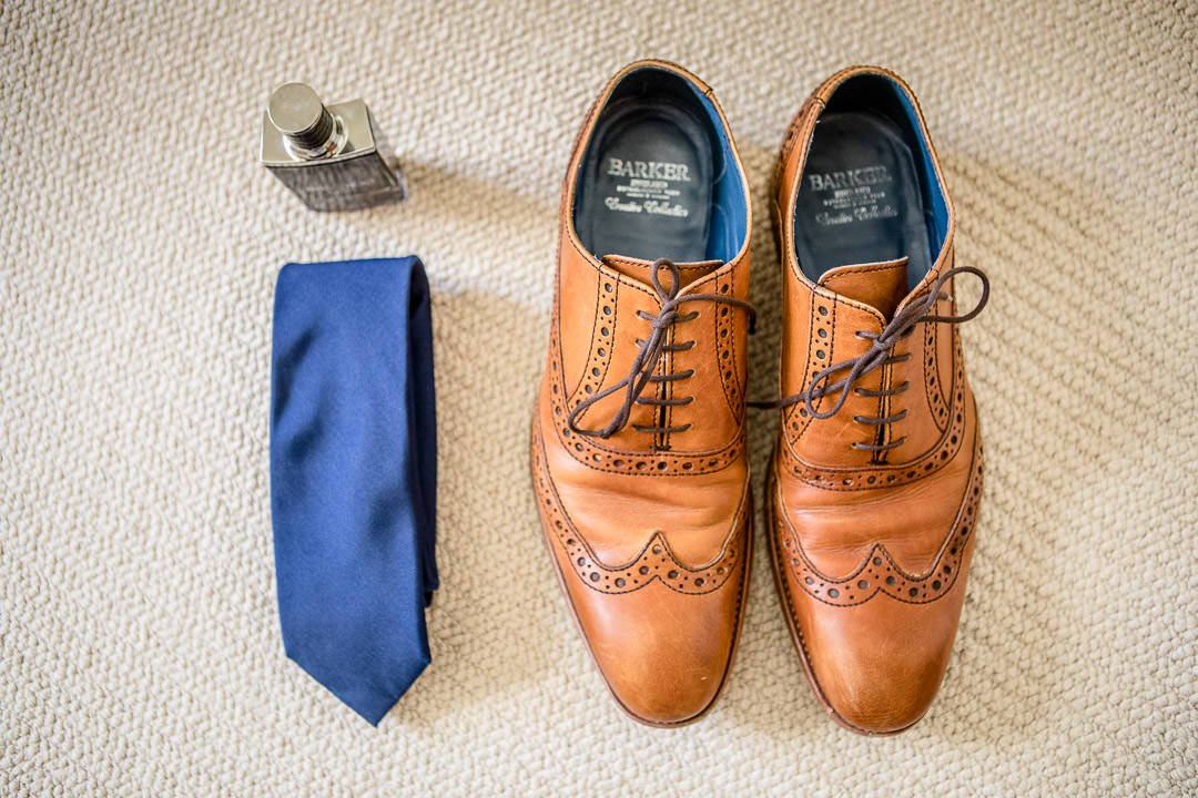 photograph of grooms shoes, tie and aftershave at the Vineyard in Stockcross, wedding venue near Newbury in Berkshire