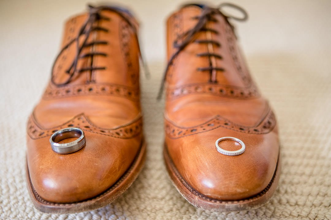 photograph of wedding rings on the groom's shoes at the Vineyard in Stockcross, wedding venue near Newbury in Berkshire