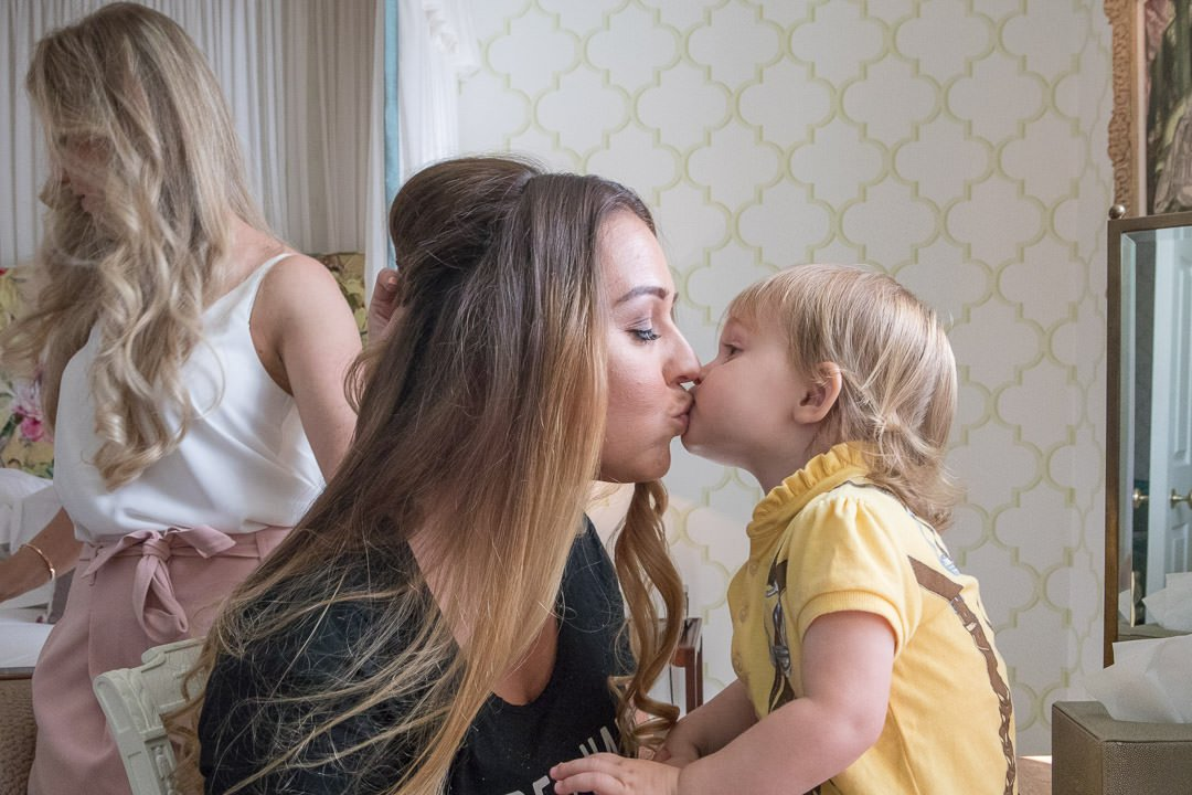 photograph of bride kissing her daughter during bridal preparation at the Vineyard in Stockcross, wedding venue near Newbury in Berkshire