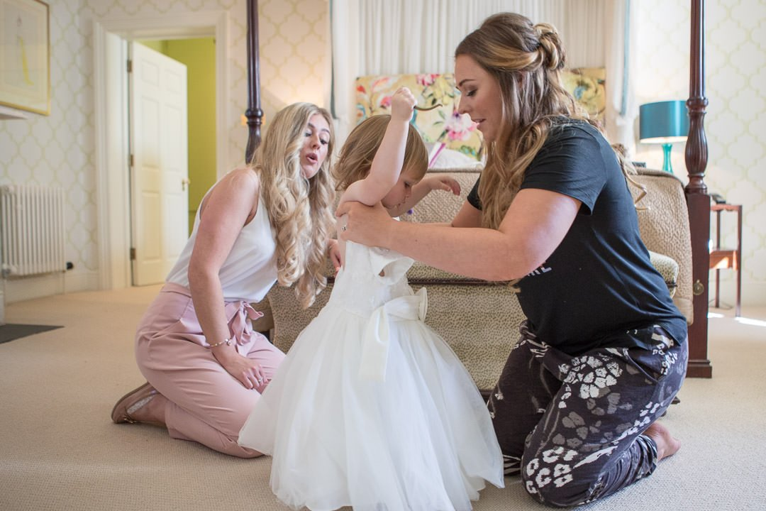 photograph of bride helping her daughter during bridal preparation at the Vineyard in Stockcross, wedding venue near Newbury in Berkshire