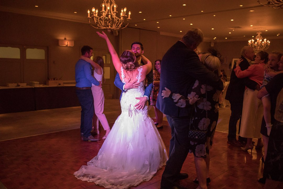 The bride and groom enjoy the first dance at the Vineyard