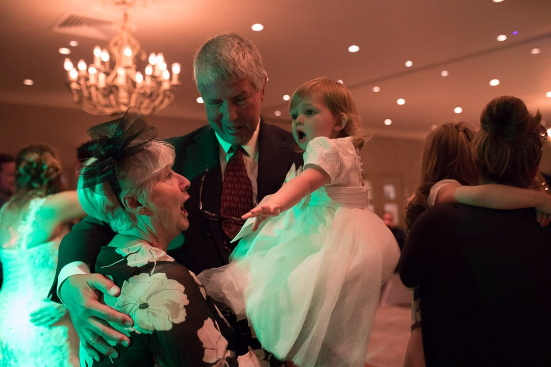 The flower girl enjoys the dancing with her grandparents at the Vineyard