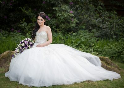 Bride sits in the gardens of Frimley Hall Hotel in Camberley-0001