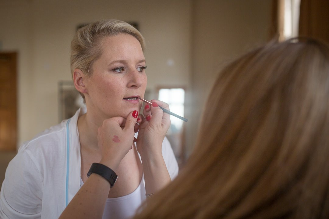 bride has her make up done before the wedding at the Elvetham Hotel in Hampshire-0001
