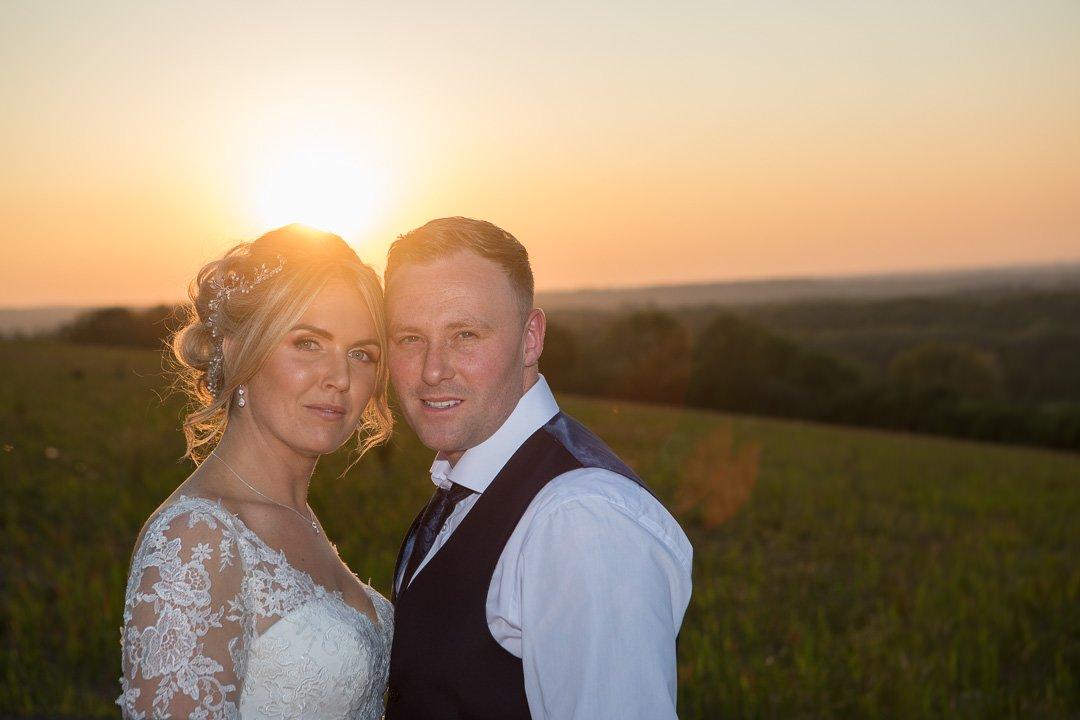 surrey bride and groom on Farnham hillside during golden hour with sunset-0001