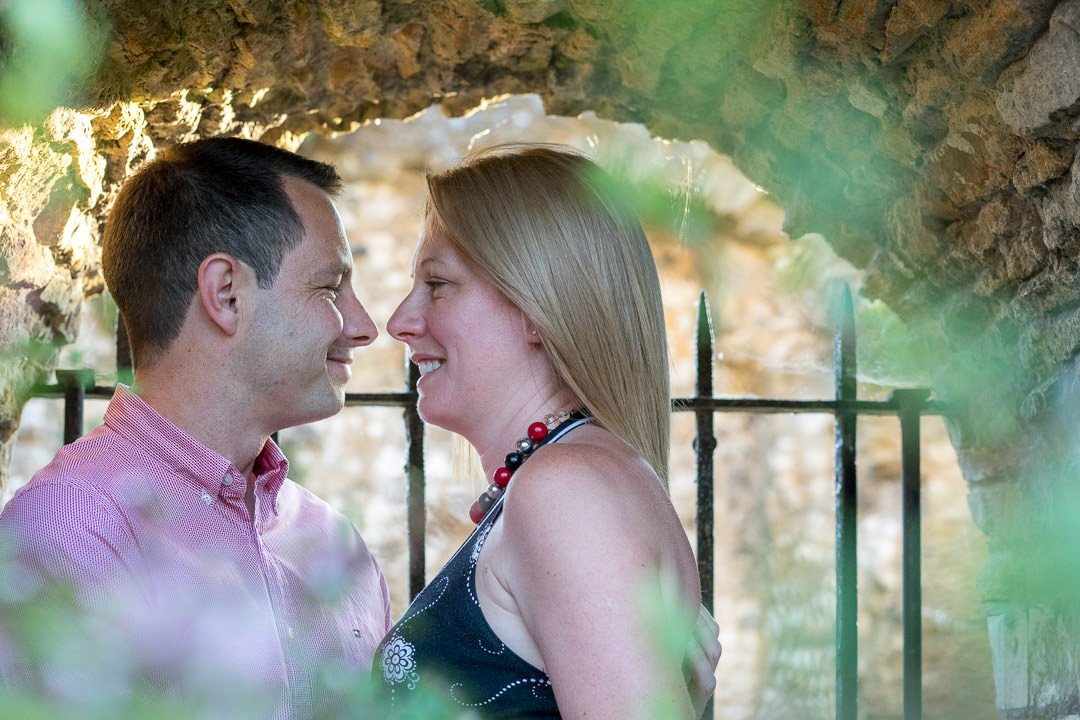 engaged couple look into each others eyes at Guildford Castle during their engagement photo session
