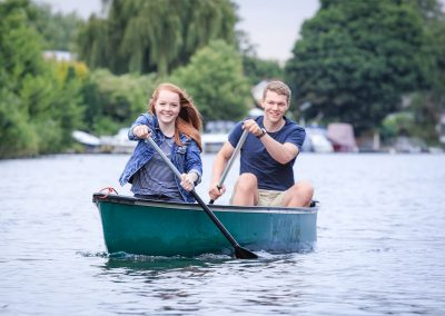 engagement photo session with young couple canoeing on the River Thames in Walton-on-Thames