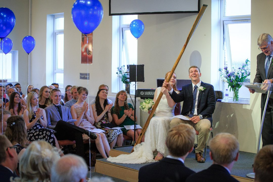 Bride and groom receive an oar during the preach from her father at Walton Baptist Church