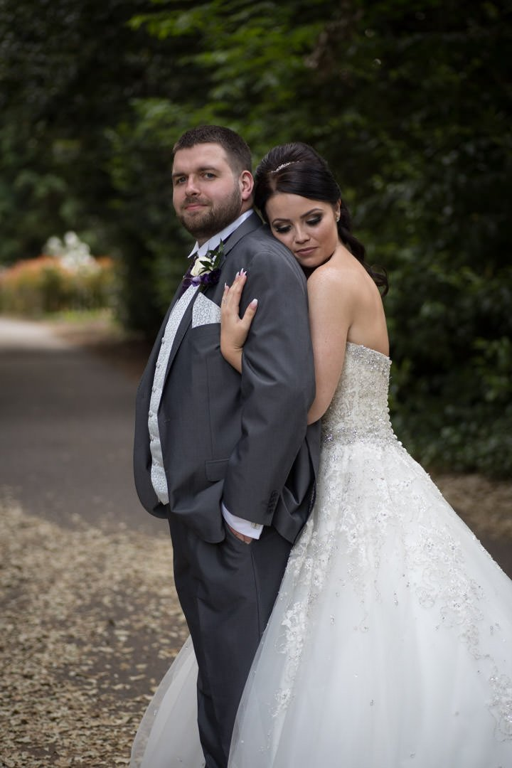 the bride hugs the groom at Frimley Hall hotel