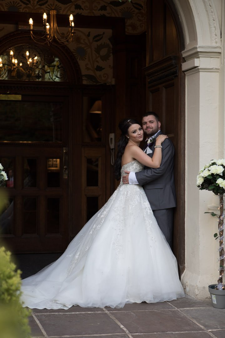 bride and groom in doorway of Frimley Hall