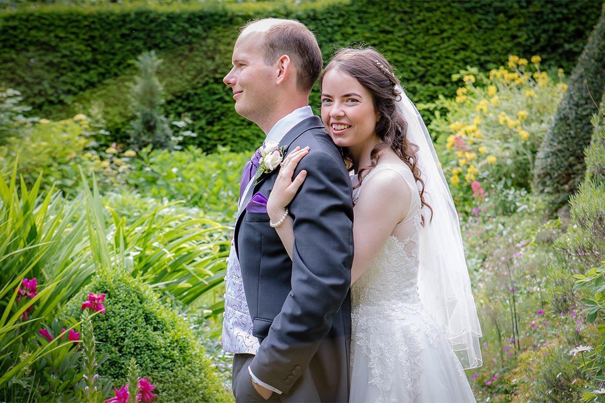 bride-and-groom-in-woking-garden-0001