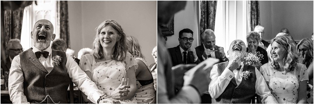 Black and whites of the groom enjoying the best men's speeches at Monk Coniston
