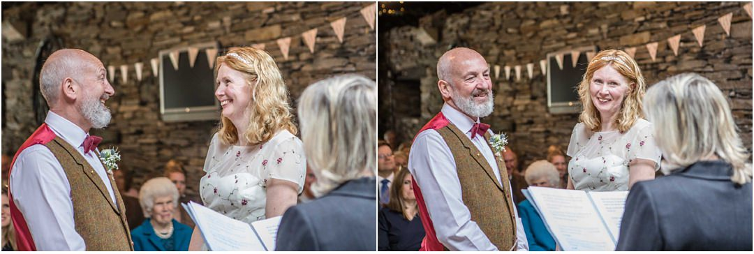smiles and laughter during the wedding ceremony in the barn at Monk Coniston
