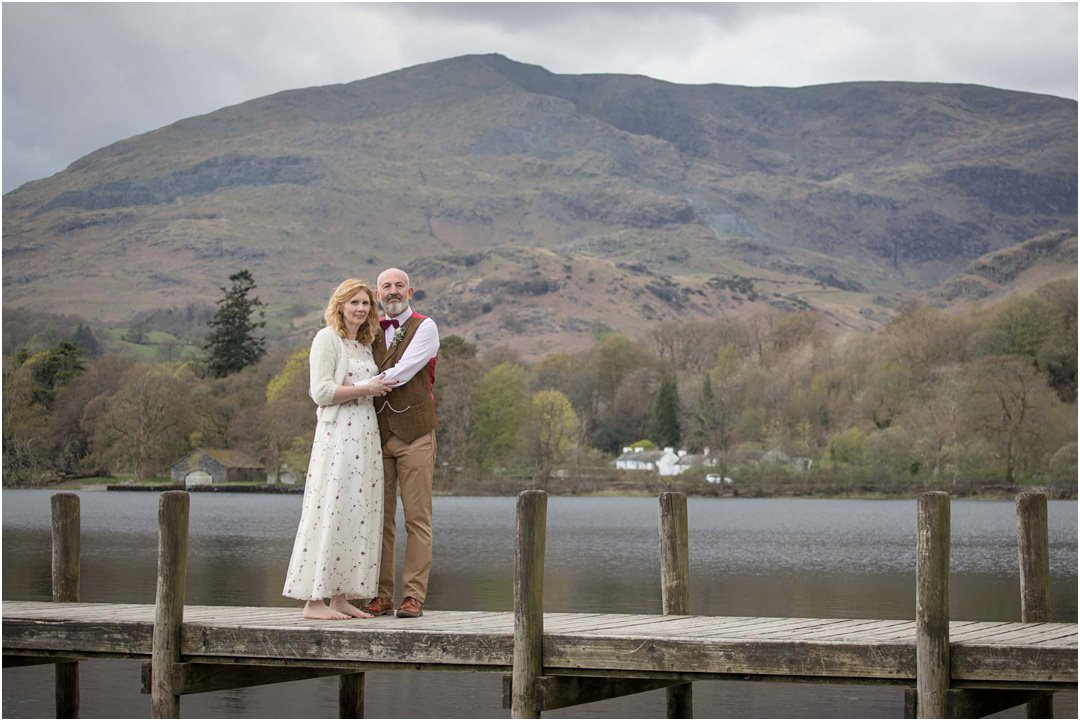 The bride and groom enjoy some couple time at Lake Coniston with the Old Man Coniston in the background